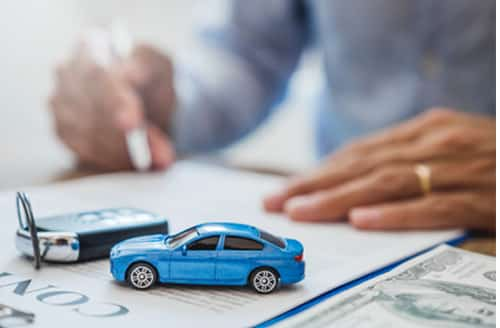 Woman signing for vehicle loan