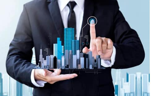Man holding city representing business loans