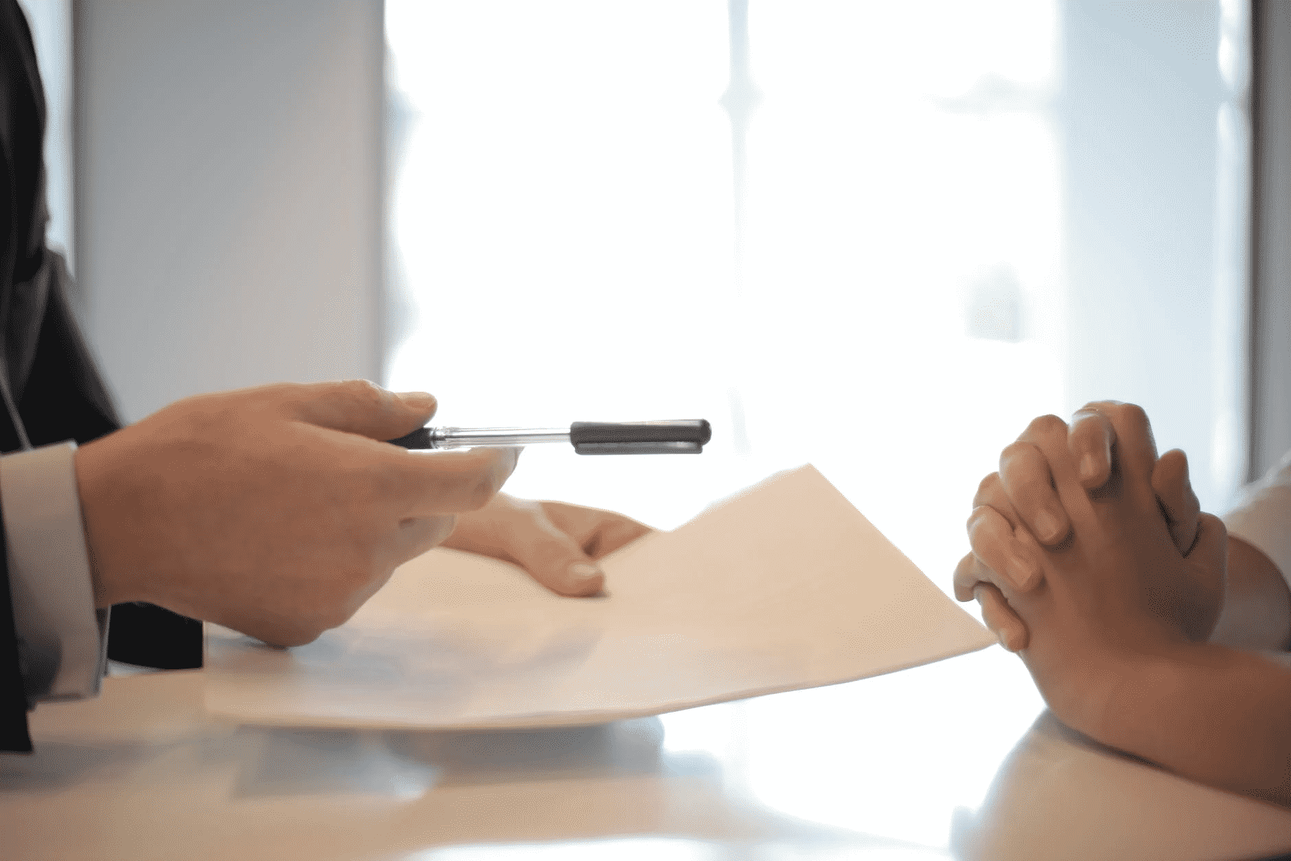 Man Holding Pen and Paper for loan application