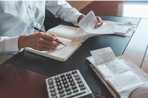Man Doing Debt Consolidation Calculations