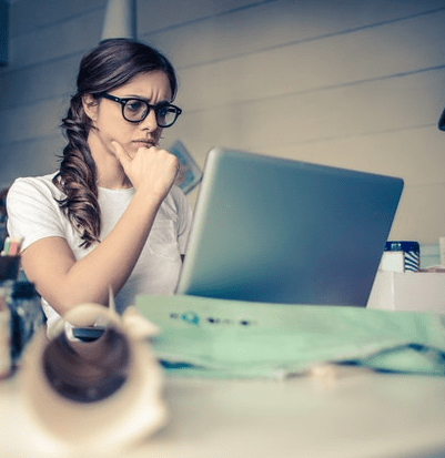 Woman thinking about unsecured personal loan