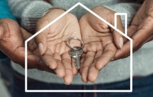 man and woman holding new key from home loan to buy house
