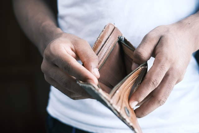 man holding open wallet empty