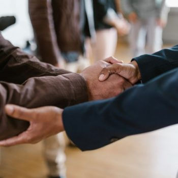 loan agency proving loan and shaking hands with business owner