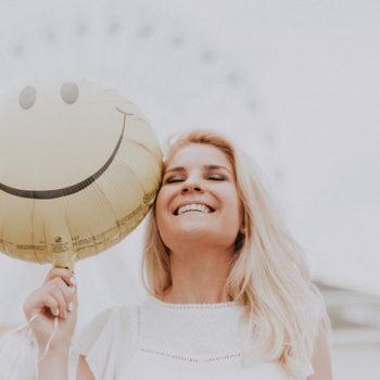 woman happy holding balloon